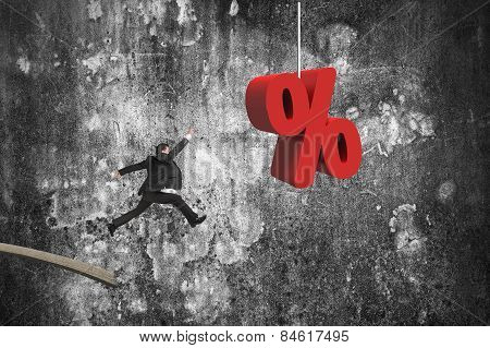 Businessman Jumping From Wooden Board To Red Percentage Sign