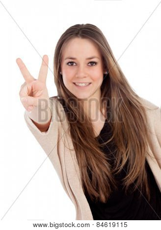 Smiling woman making the sign of victory isolated on a white background. With focus on hand