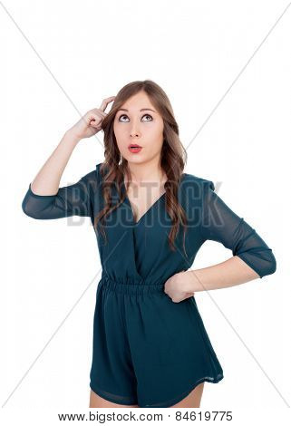 Pensive girl remembering something isolated on a white background