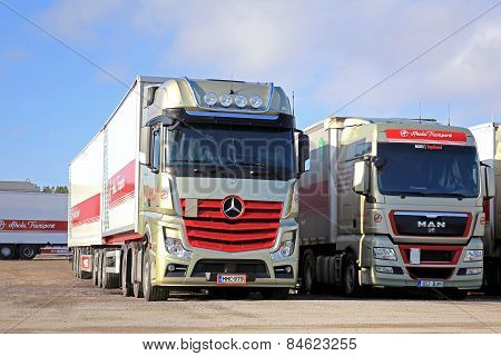 Red Mercedes-Benz Actros 2551 And MAN Trucks On A Yard
