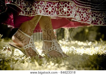Close up of young Hindu Indian bride's feet dancing in garden