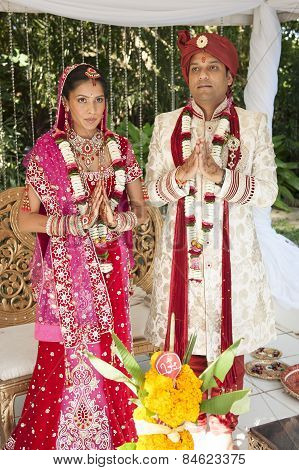 Young Hindu Indian couple wearing traditional wedding clothes on wedding day