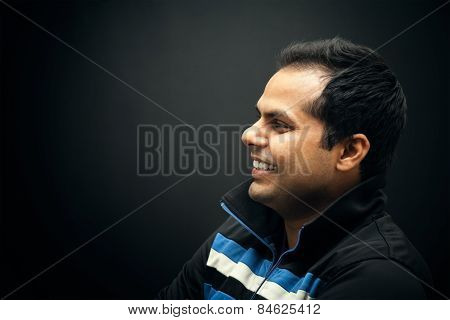 Portrait of young Indian smiling man
