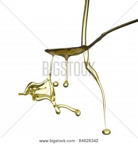 Pouring oil splash. Isolated on white background.