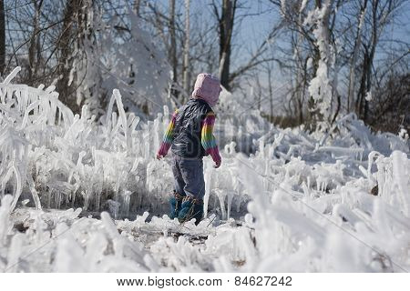 Little Girl On A Walk Among The Ice