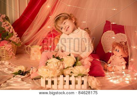 Little girl wearing pink dress as a princess