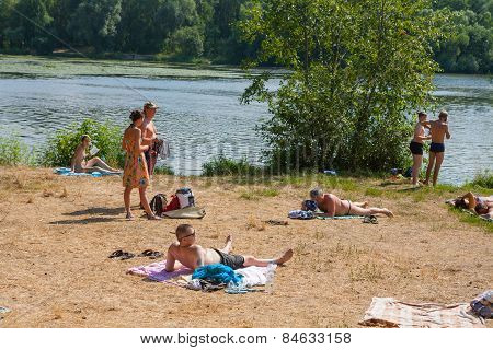 People Relaxing On A Beach