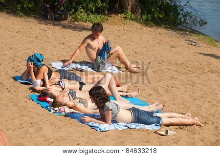 People Lying On The Litter And Sunbathing