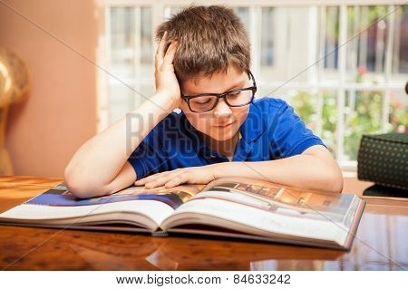 Little Boy Reading A Big Book