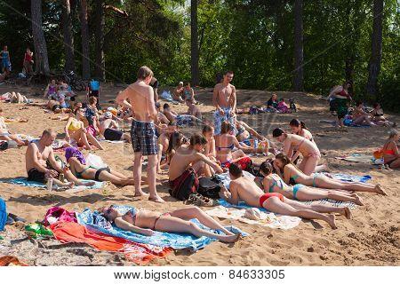 Girls And Guys Sunbathing In Beach