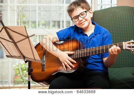 Happy Boy Playing The Guitar