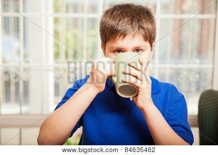 Kid Drinking Some Coffee