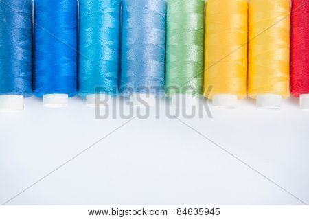 Colored Threads On A White Background
