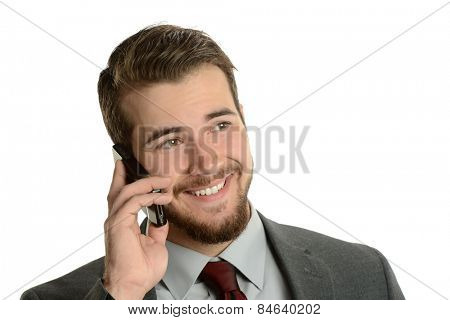 Young Businessman on the cell phone isolated on a white background