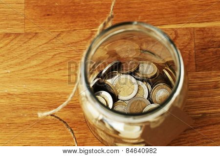 Finances. Euro coins in a jar