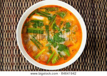 Thai Tom Yam traditional soup in plate