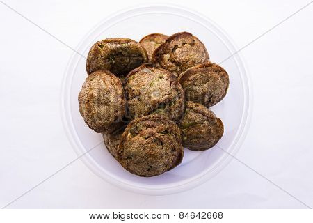 Indian cuisine ~ fried puffed balls made from mould filled with dough of finger millet & rice powder