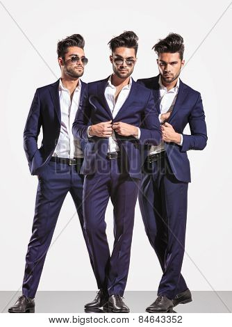 three poses of an elegant smart casual fashion business man on light gray background