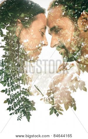 Double exposure portrait of a couple combined with photograph of nature