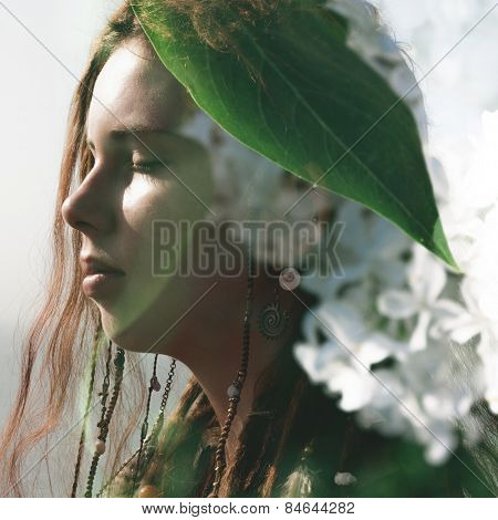 Double exposure portrait of a attractive gorl combined with photograph of lilac flowers