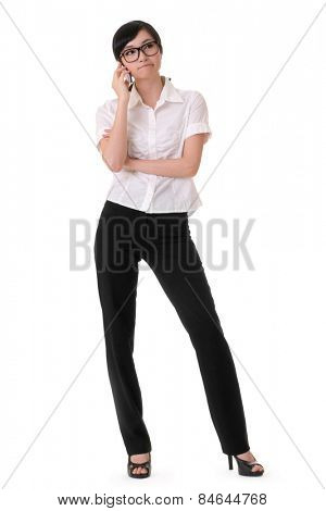 Worried business woman holding cellphone and listening, full length portrait on white background.