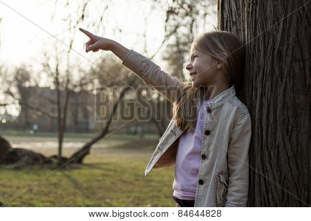 Little Girl In The Park Pointing