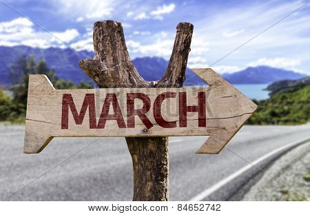 March sign with road background