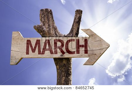 March sign with sky background