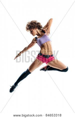 young beautiful dancer jumping on a studio background