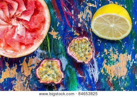 Passion Fruit, Lemon And Grapefruit Halves On A Colorful Background