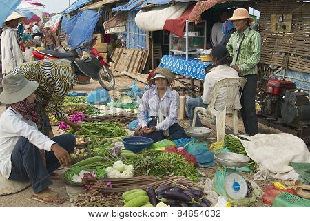 People sell vegetables at the local market in Siem Reap, Cambodia.