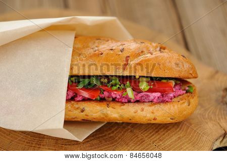Sandwich With Beetroot, Bell Pepper And Scallion Wrapped In Paper