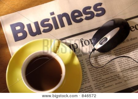 Coffee, Newspaper and Mouse on Desk