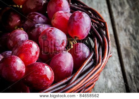 Organic Ripe Grapes ?? The Basket On Wooden Table