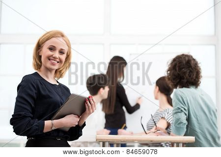Businesswoman with tablet computer in office