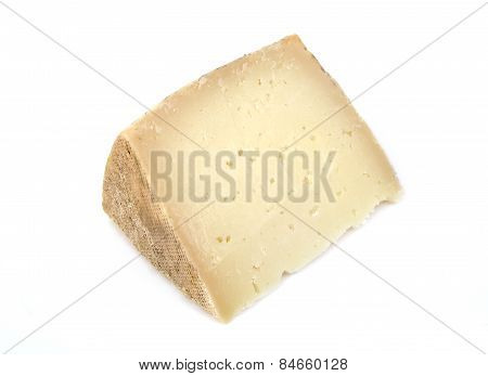 Delicious wedge of spanish machego cheese on a white background