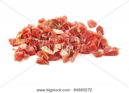 Bunch of sliced spanish serrano ham on white background