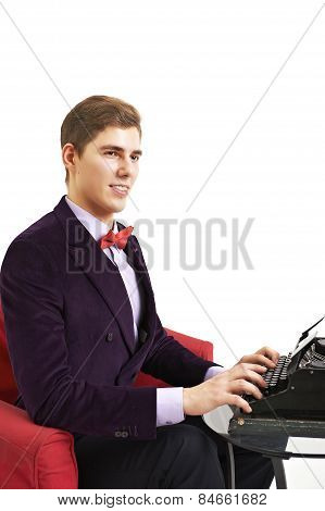 Author typing on a typewriter