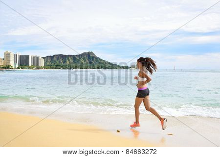 Woman runner - Sport running fitness girl jogging on beach run Female athlete jogger training living healthy active exercise lifestyle exercising outdoor on Waikiki Beach, Honolulu, Oahu, Hawaii, USA.