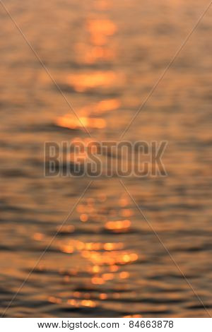 Blur Background Of The Water Surface At Sunset