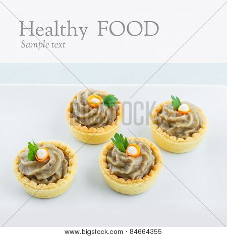 Salty mini tartlets stuffed with baba ganoush