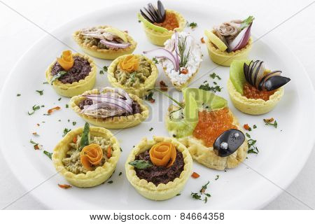 Assorted savory holiday snacks on plate