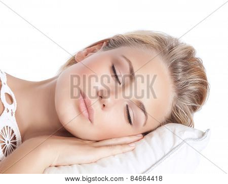 Closeup portrait of cute blond serene girl sleeping, attractive gentle female with closed eyes lying down on the pillow isolated on white background, peace and harmony concept