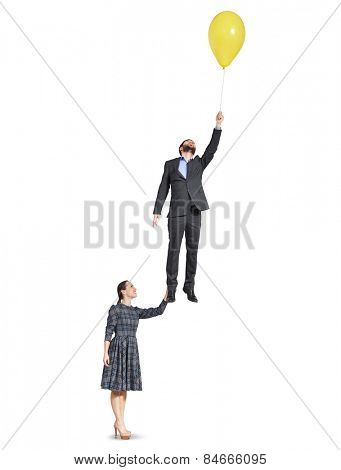 smiley woman holding happy flying man. isolated on white background