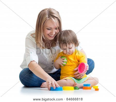 child and mother playing with toys