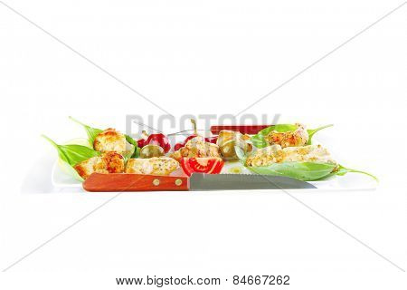 fried chick on long white plate with vegetables
