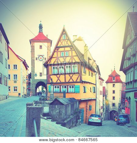 Street in Rothenburg ob der Tauber, Germany. Retro style filtred image