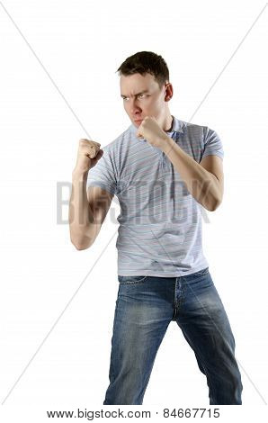 Angry Man Threatens His Fists On A White Background