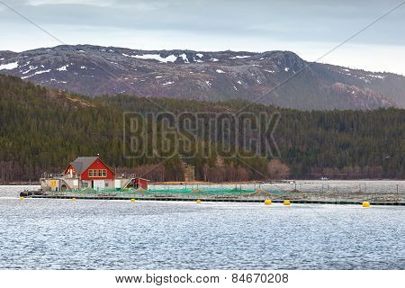 Norwegian Floating Fish Farm With Red Wooden House