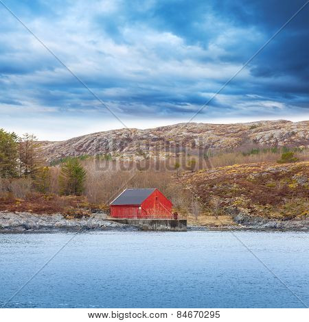 Traditional Norwegian Red Wooden Boat Barn With Crane
